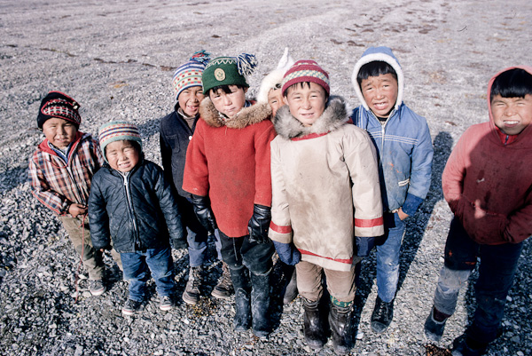 Resolute 1968 - The eight children are ( from left to right ): Joelee, Harry Maseo, and Mathew Nungaq. Peter Amarualik is in the red parka, with Joadamie Amagualik peeking behind. Beside them is Eli Allakariallak with Manasie Amagualik and Johnny Nungaq.